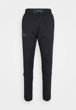 STORM PANTS - Tracksuit bottoms - black