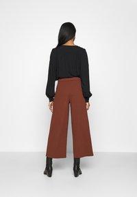 JDY - JDYGEGGO NEW ANCLE PANTS - Trousers - cherry mahogany/black - 2