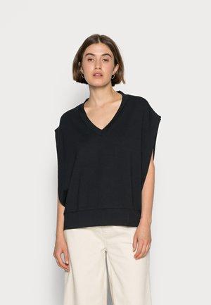 KIRA SLIPOVER - Basic T-shirt - pitch black