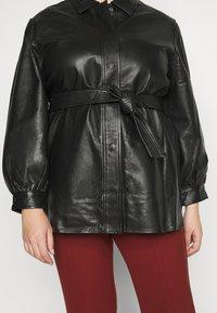 Selected Femme Curve - SLFLEA LONG JACKET - Faux leather jacket - black - 5