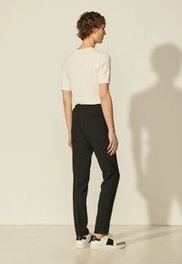 sandro - Trousers - noir - 2