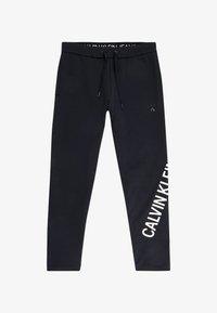 Calvin Klein Jeans - Tracksuit bottoms - ck black - 4