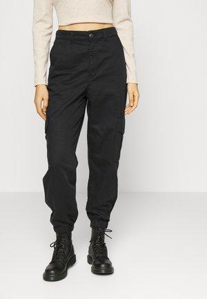 JXHOLLY PANT - Reisitaskuhousut - black