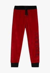 Jordan - AIR LEGACY PANT - Teplákové kalhoty - gym red - 2