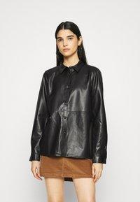 Vila - VINALIA COATED - Button-down blouse - black - 0