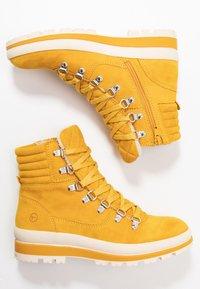 Tamaris - Lace-up ankle boots - saffron - 3