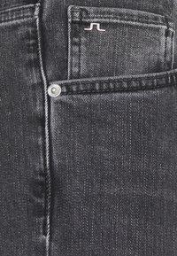 J.LINDEBERG - JAY SLATE WASHED JEANS - Slim fit jeans - black - 2