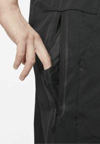 Nike Sportswear - Tracksuit bottoms - black/black - 4