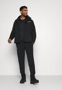 adidas Performance - FOUNDATION RAIN.RDY HIKING JACKET - Hardshell jacket - black - 1