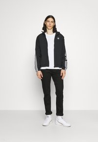 adidas Originals - LOCK UNISEX - Tunn jacka - black - 1
