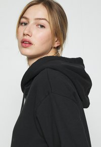 Levi's® - GRAPHIC STANDARD HOODIE - Sweat à capuche - black - 4