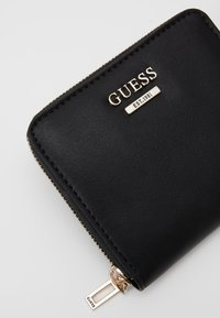 Guess - TANGEY SMALL ZIP AROUND - Wallet - black - 3