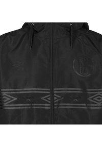 Umbro - Light jacket - black - 2