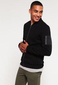 Urban Classics - Zip-up hoodie - black - 0