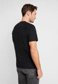 Napapijri - SASTIA  - T-Shirt print - black - 2