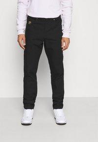 Karl Kani - OG PANTS UNISEX - Cargo trousers - black - 0