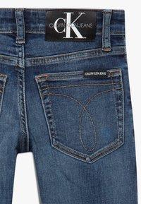 Calvin Klein Jeans - DESTROY - Jeans Skinny Fit - blue - 4