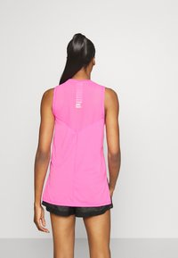 Puma - TRAIN PANEL TANK - Sports shirt - luminous pink - 2