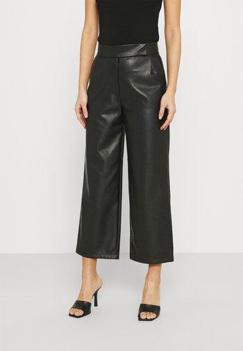 VIVIEN - Trousers - black