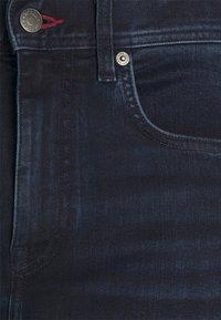 Tommy Hilfiger - CORE BLEECKER SLIM - Slim fit -farkut - iowa blueblack - 6