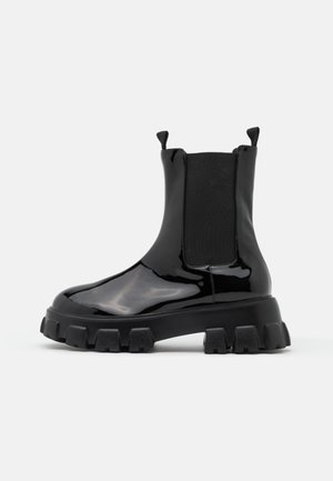 BITE IT CHELSEA BOOT - Platform ankle boots - black
