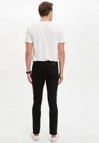 DeFacto - Slim fit jeans - black - 1