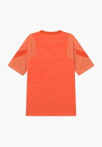 Nike Performance - Print T-shirt - melon tint/total orange - 1