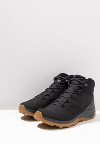 Salomon - OUTSNAP CSWP - Winter boots - black/ebony - 2