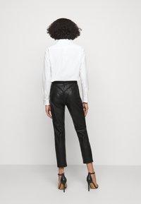 Pinko - SUSAN TROUSERS - Spodnie materiałowe - black - 2