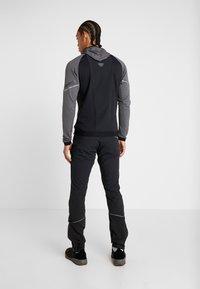 Dynafit - TRANSALPER PRO  - Outdoorové kalhoty - black out - 2