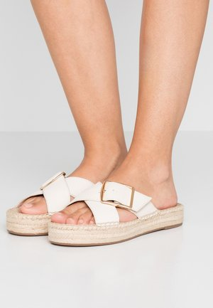CROSS WITH BUCKLE - Mules - ivory
