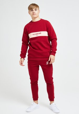 ILLUSIVE LONDON DIVERGENCE  - Træningsbukser - red & pink