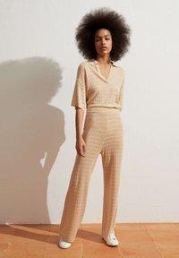 OYSHO - Trousers - beige - 1