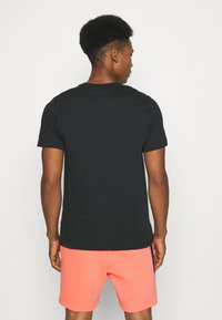 Nike Sportswear - ALUMNI - Träningsbyxor - turf orange - 5