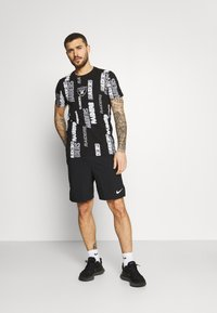 New Era - NFL LAS VEGAS RAIDERS RETRO SPORTS TEE - Print T-shirt - black - 1