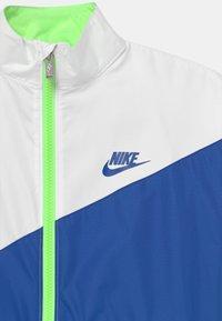 Nike Sportswear - PACKABLE WIND  - Training jacket - lime glow - 2