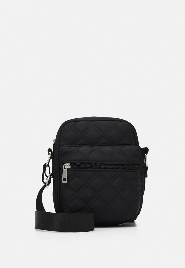 BAG HILDA QUILTED - Across body bag - black