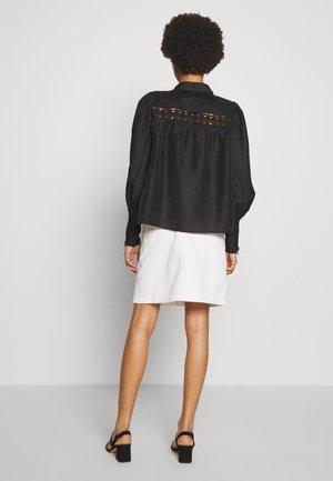 CIARA - Button-down blouse - black