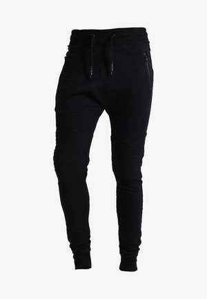 TREVOR ZIP - Tracksuit bottoms - black