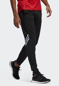 adidas Performance - RUN IT 3-STRIPES ASTRO JOGGERS - Pantalon de survêtement - black - 3