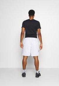 Nike Performance - DRY SHORT PRINT - Sports shorts - white/game royal - 2