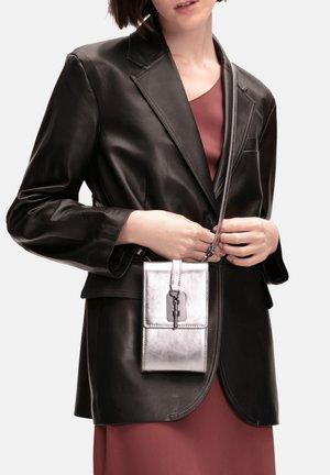 Across body bag - silver lead