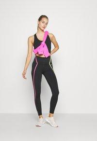 Puma - TRAIN BONDED ZIP HIGH RISE FULL - Leggings - black/pink/yellow - 1