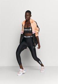 Calvin Klein Performance - LOW SUPPORT BRA - Light support sports bra - black - 1