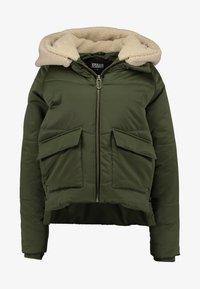 Urban Classics - LADIES SHERPA HOODED JACKET - Winter jacket - dark olive/dark sand - 6