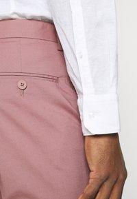 Jack & Jones PREMIUM - JPRLIGHT SID TROUSER - Trousers - soft pink - 4