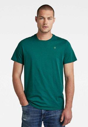 BASE S - T-shirt med print - bright laub