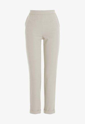BRENDA - Trousers - sand