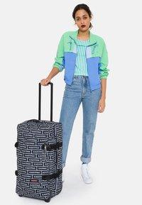 Eastpak - TRANVERZ M - Wheeled suitcase - bold branded - 1
