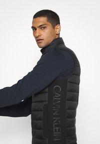 Calvin Klein - LIGHT WEIGHT SIDE LOGO VEST - Waistcoat - black - 4